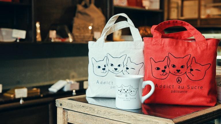 モデルはシェフの愛猫「ジョゼ」。トートバッグやマグカップなどのグッズも人気!